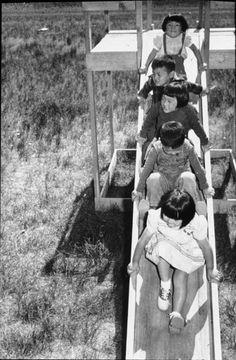 Tule Lake Relocation Center. Children on playground equipment which internees built from scrap wood.