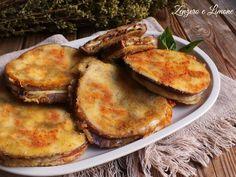 Queste cotolette di melanzane imbottite con provola e pomodori secchi sono un piatto facile da realizzare, saporito e molto invitante.