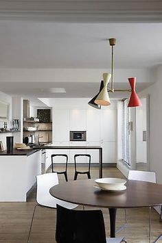 Spare and sculptural- kitchen and dining space designed by Rose Uniacke.