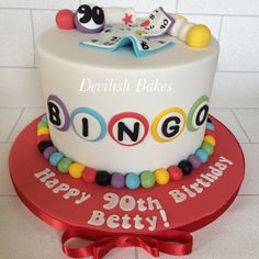 Colourful bright Bingo cake. Edible cake toppers, all hand made by Devilish…