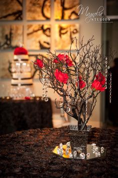 For centerpieces? red, champagne, white, black wedding - Google Search Replace the red flowers with purple