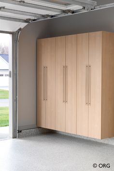 Cabinets By The Garage Doors For Sporting Goods And Rakes Broom Storage Innovate Home Org Columbus Cleveland Ohio