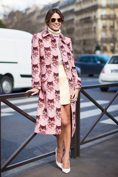 Helena Bordon poses in a pink cat coat with a turtleneck and leather skirt.