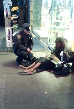 Jennifer Foster, visiting New York, snapped this pix of Ofc. Lawrence Deprimo helping a homeless man put on a pair of boots. It was a cold night in Times Square, Officer DePrimo was working a counterterrorism post when he encountered an older, barefooted homeless man. The officer disappeared for a moment, then returned with a new pair of boots, & knelt to help the man put them on. Her snapshot has made Ofc. DePrimo an Internet hero. It has been viewed over 1.6 million times on You Tube