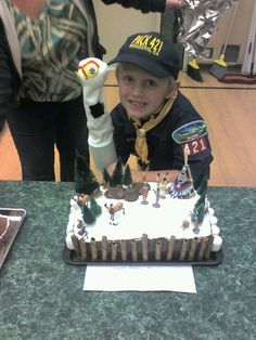 Wyatt with his cake he made for auction for cub scouts