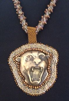 Golden Lion focal of bead embroidery. Ultra suede on back.