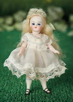 """French All-Bisque Mignonette with Brilliant Blue Eyes---5""""painted white stockings and black two-strap shoes, antique costume. Condition: generally excellent. Comments: for the French market, circa 1890. Value Points: pert features dramatize the pale complexion and cobalt eyes."""