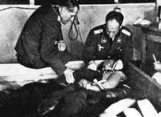 Nazi medical experiments: a prisoner is submerged in a tank filled with cold water. The goal of this type of experiments was to check how long German pilots, who had to parachute into the cold north sea, would survive. Different types of clothing were tested, as well as different methods for reviving the experimental subjects who survived.
