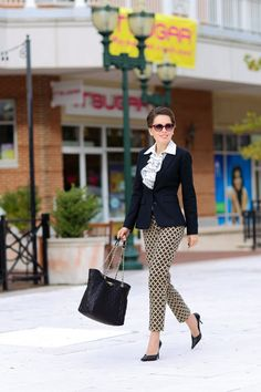 Corporate Chic | Out of the Box Can you incorporate your personality into a strict corporate dress code? Absolutely! A playful, printed ruffled blouse paired with printed pants can do just that while the black blazer maintains the conservative, professional vibe and prevents from the patterns getting too busy. My ethics professor tried to hammer it into my brain that black and brown don't mix in the same outfit. As you can tell, I'm rather stubborn.