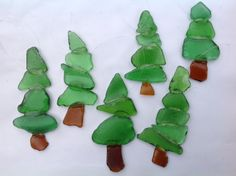 Set of six Christmas tree ornaments. Made from Lake Erie beach glass and clear coated to allow light through, these ornaments would make a great addition to your tree or given as a unique gift. Fishing line was used to hang the ornaments.