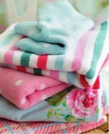 Cath Kidston...love these colorful towels, cottage whimsy bathroom