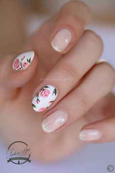 A simple yet very pretty rose nail art design. The background color is white and… A simple yet very pretty rose nail art design. The background color is white and cheer with small pink roses painted on top seemingly framing the nails delicately. Rose Nail Art, Floral Nail Art, Rose Nails, Flower Nails, Nail Art Flowers, Flower Art, Pretty Nail Designs, Simple Nail Designs, Nail Art Designs