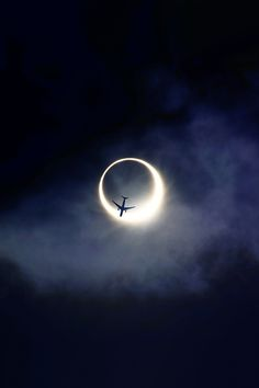 Plane over eclipse