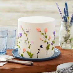 Soft and feminine, this Breath of Spring Floral Cake is a wonderful way to celebrate a baby shower, wedding shower or mom's birthday. After you're done icing your cake, simply use a toothpick to make stems for your flowers, then use a variety of tips Pretty Birthday Cakes, Pretty Cakes, Cute Cakes, Flower Birthday Cakes, Cake Birthday, Beautiful Cakes, Birthday Cake Designs, Elegant Birthday Cakes, Happy Birthday