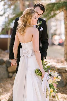 Love the gorgeous lines of this wedding dress, perfect for a winter wedding in South Lake Tahoe! There is no place more beautiful for your destination wedding than South Lake Tahoe. Find out why South Shore is the fun side of the lake. #destinationwedding #winterwedding www.tahoeweddingsites.com