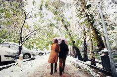 Iranian couple walking in the city.