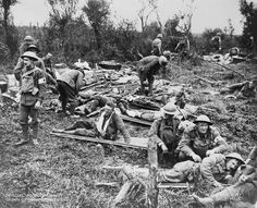 """Regimental Aid Post  or """"dressing station"""" in open ground near Monchy le Preux in 1917. Located near the front line in a reserve trench would be the Battalion Medical officer, orderlies and stretcher bearers.  Front line units such as infantry provided only the most basic care, perhaps light first aid or a drink before passing the wounded  to the Advanced Dressing station.Transport was by walking,hand cart, wheeled stretchers or trolley lines-depending on the conditions."""