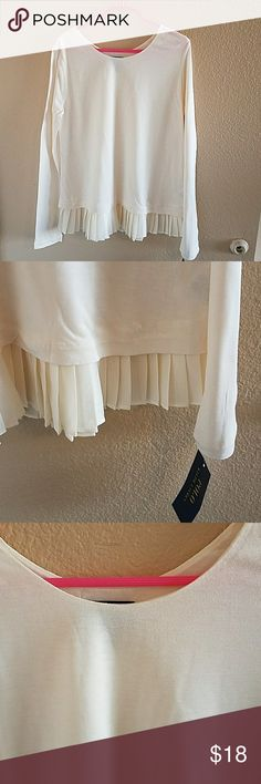 Polo Ralph Lauren Girls Cream Top Size M NWT NWT Beautiful Polo Ralph Lauren Girls Cream Top Size Medium 8/10. Soft and Comfy 100% Polyester. Pretty ruffle hem adds a beautiful detail Polo by Ralph Lauren Shirts & Tops