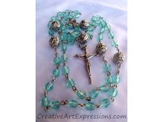 Sold-$30.00  Creative Art Expressions Handmade Light Blue Rosary.  www.CreativeArtExpressions.com