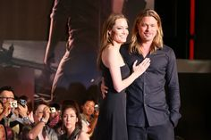 Pin for Later: Look Back at Brad and Angelina's Sexiest PDA Moments  The couple cozied up on the red carpet at the Tokyo premiere of Brad's flick World War Z in July 2013.