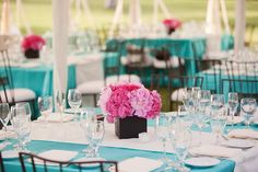 Taken from wedding reception, but would be so cute for Birthday party with bright tableclothes & pink accents