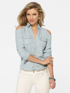 Long sleeve button front denim shirt with open shoulders. Breast patch pockets. V-neck with collar. 100% tencelImportMachine was