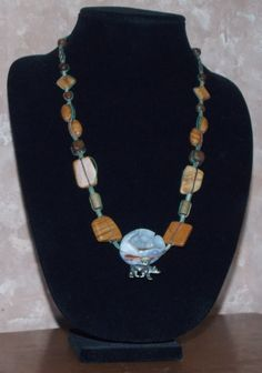 This necklace features beautiful brown jasper pieces in three shapes and a gorgeous white geode crystal cave!  Bear and Crystal Cave Necklace; Handmade Hemp Jewelry; Adjustable Necklace; Wood Jasper Beaded Necklace; Bear Fetish; Bear Totem from Exquisitely Original