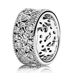 This wide sterling silver statement ring features an intricate pattern of winding branches and dainty leaves encrusted with cubic zirconia stones. With its refined expression and carefully crafted details, it is the ideal piece for both day and evening wear.