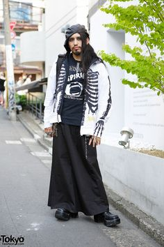 Uraguchi Nyugaku is a DJ who you might recognize from our #Fangophilia photo shoot and video. When we ran into him in Harajuku, he was wearing a skeleton jacket, a Suspiria t-shirt, silver jewelry from the Japanese brand Roroji, a maxi-skirt, and boots. #tokyofashion #street snap #Harajuku