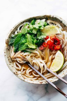 This Easy Turkey Pho recipe is LIGHT and so flavorful. All familiar ingredients that can be bought at a mainstream grocery store. Perfect for leftover turkey! | pinchofyum.com