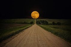 Supermoon rises over road to nowhere in eastern South Dakota. Photography by Aaron J. Groen