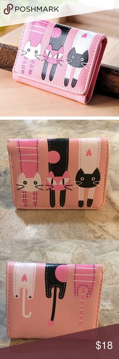 🆕 Pink Kitty Cat Wallet This tri-fold wallet is faux leather. It has 3 card slots and a windowed slot for your i.d. Botusi Bags Wallets
