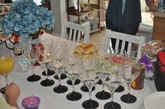 """@Stephanie Saylor made these for my bridal shower!  Wine glasses dipped in chalkboard paint with a dish filled with chalk wrapped in aqua ribbon. Never lost my """"Bride to be"""" glass."""
