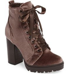 A stacked, sky-high heel and lugged platform sole generously lift this striking lace-up bootie.