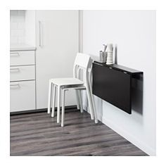 IKEA - BJURSTA, Wall-mounted drop-leaf table, Becomes a practical shelf for small things when folded down.You save space when the table is not being used as it can be folded away.The clear-lacquered surface is easy to wipe clean.Seats 2.