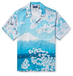 <a href='http://www.mrporter.com/mens/Designers/Blue_Blue_Japan'>Blue Blue Japan</a> is equally inspired by age-old Japanese culture and vintage clothing design. This camp-collar shirt is a case in point, printed with images of Mount Fuji and sakura blossoms, using traditional indigo-dyeing techniques. Go for an eclectic look and wear yours open over a graphic tee.