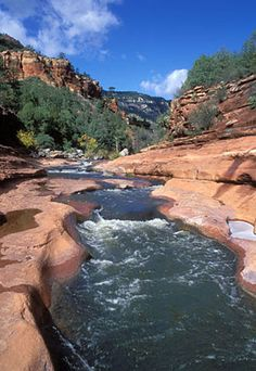 Slide Rock State Park, Sedona, AZ - a slippery natural water slide that formed in the sandstone of the Oak Creek Canyon - water temperature in the summer averages 63°F