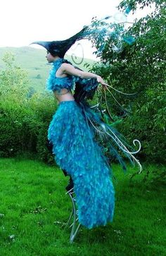Feathers on your fingers? TICKLE TIME! #stilts #bird #costume