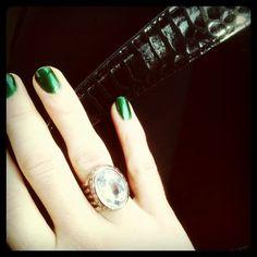 Green nails and bling.