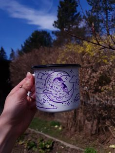 """✧✧✧BABY BIRD ENAMEL MUG✧✧✧ ✧Choose this unique hand painted camping mug for your favourite hikings, tea time or coffee with friends! Calm cloudy night with starry sky; this flycatcher baby bird is already in her dreamland while cozy on her moon bed. """"Dreams can come true"""" she once said to me✧ Mug is handpainted with a little bit of imagination and a bit of magic✧ its perfect as a gift for your loved ones, or you might just gift it to yourself!✧ Cloudy Nights, Coffee With Friends, Hand Painted Mugs, Tea Mugs, Tea Time, Imagination, Best Gifts, Enamel, Calm"""