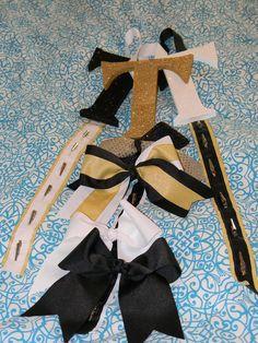 SM Cheer Bow Holders Custom Made. $10.00, via Etsy.  Great idea!  I'm so making this for my cheerleader!!!