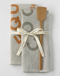 COOK + EQUAL SET Tools of the trade: COOK and EQUAL tea towels are hardworking, helpful and will last a lifetime. Completing the set is a one-of-a-kind handcrafted wooden spatula from our favorite woodworker in Vermont. Slate and copper ink on 100% rustic oatmeal linen.