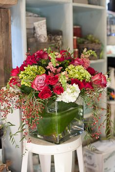 Pinks and reds summer arrangement with roses, stock, and mini green hydrangea. #aspen #summer