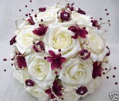 WEDDING FLOWERS POSY BOUQUET IN IVORY ROSES WITH BURGUNDY AND GOLD TRIM