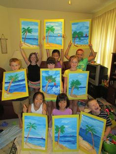 My students proudly showing off their paintings in the summer art camp! Art teacher: Susan Joe