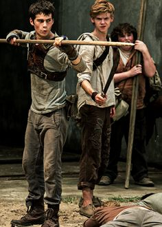 Newt is like: Thomas the crud are you doing And Thomas is like: no do not worry I can handle this I promise look at me with a big stick ima man now
