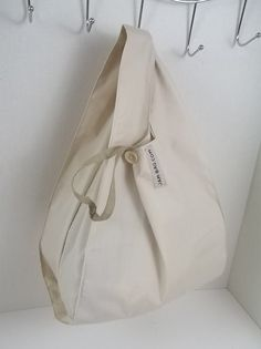 FOLDBAG // Foldable Lunch Bag - Ivory Solid // Small Grocery Bag w/ Strap and Button Closure | reusable shopping bag, reusable grocery bag by dyampyon on Etsy https://www.etsy.com/listing/275334370/foldbag-foldable-lunch-bag-ivory-solid
