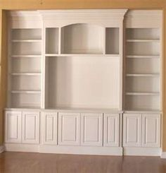 we will eventually build one of these in our living room.  our small house NEEDS the storage and shelves.  i'm really liking this one!
