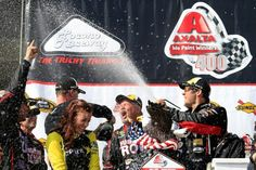 Martin Truex Jr celebrates his first win of 2015 at Pocono Axalta400