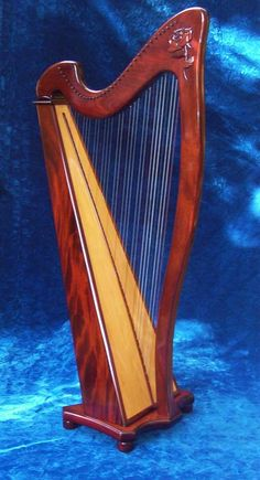 Talis harp! Same style with curly Maple wood. I love playing this harp! Beautiful sound!